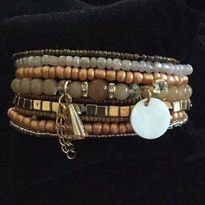 9 LAYER BROWN and GOLD TONE STRETCHY BRACELET